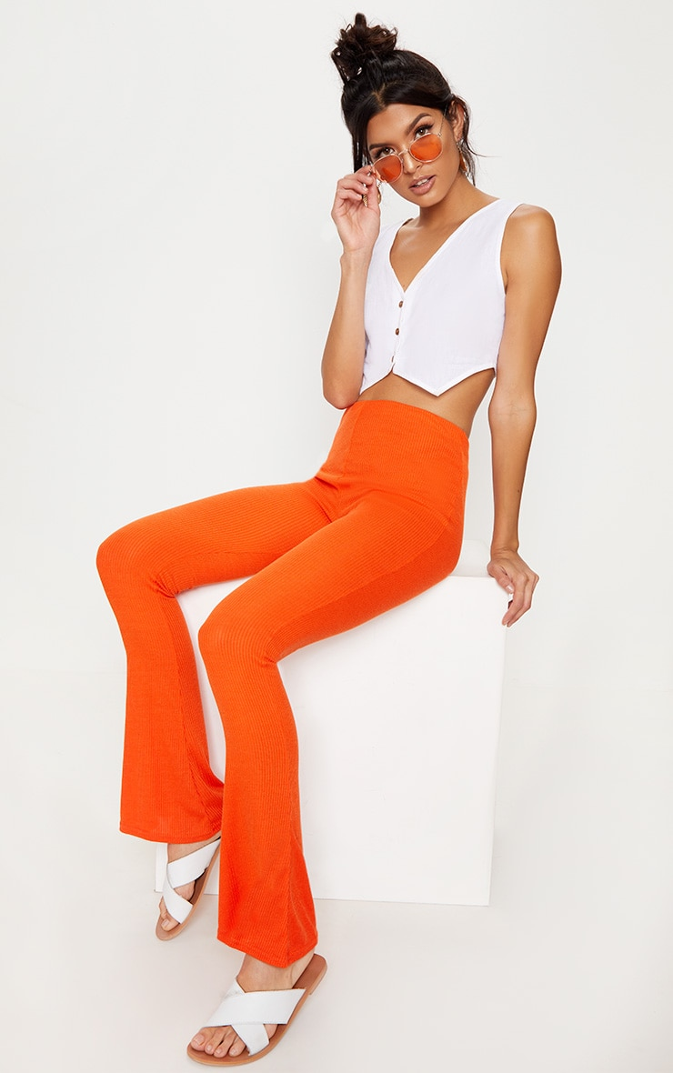 Tangerine Ribbed Flared Trousers