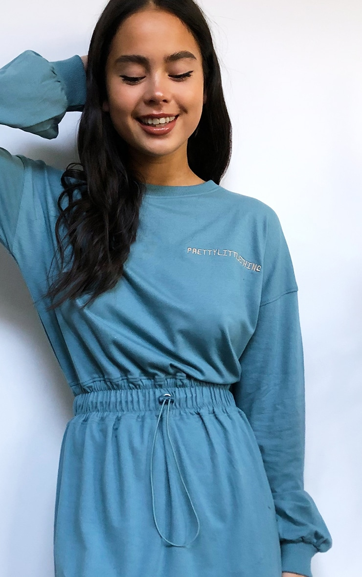 PRETTYLITTLETHING Slogan Washed Teal Toggle Waist T-Shirt Dress 4