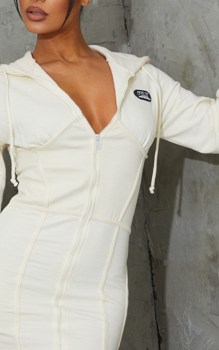 PRETTYLITTLETHING Cream Badge Rib Waist Detail Zip Up Jumper Dress 4