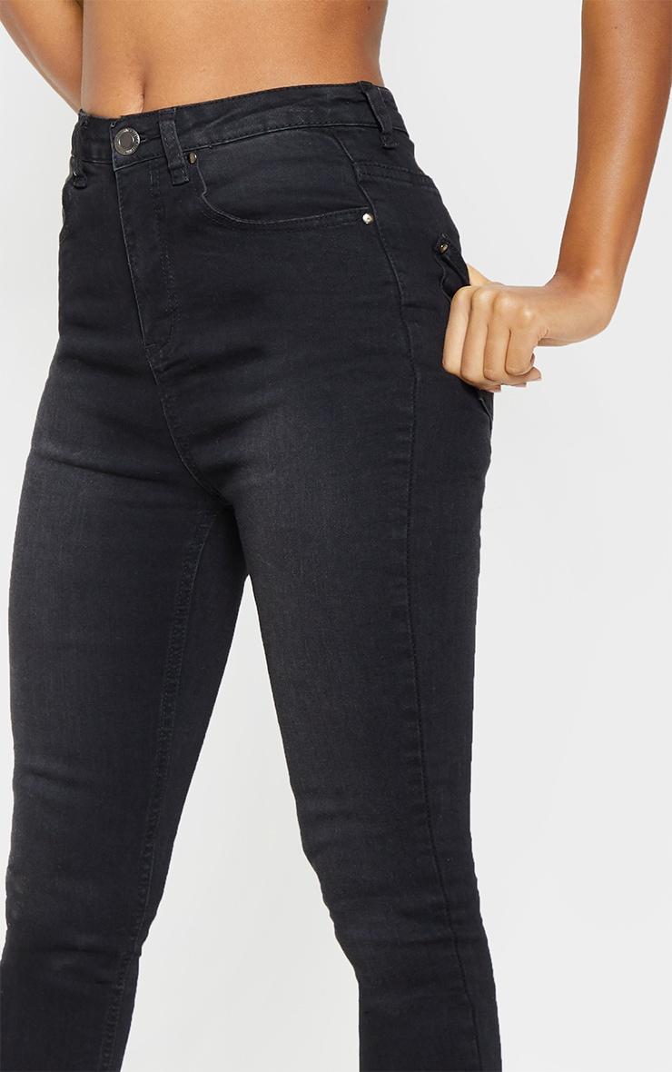 2cfd3cc001063d Jean skinny taille haute noir délavé à 5 poches. Denim ...