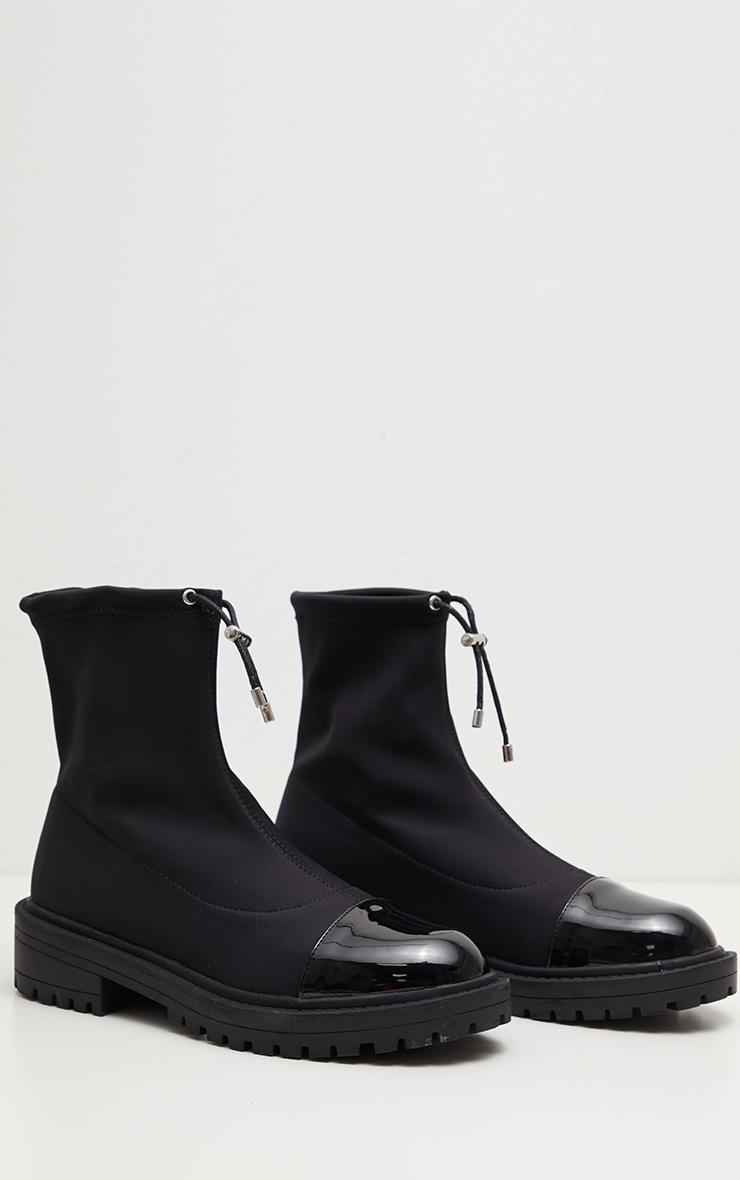 Bottes-chaussettes à crampons noires en lycra 3