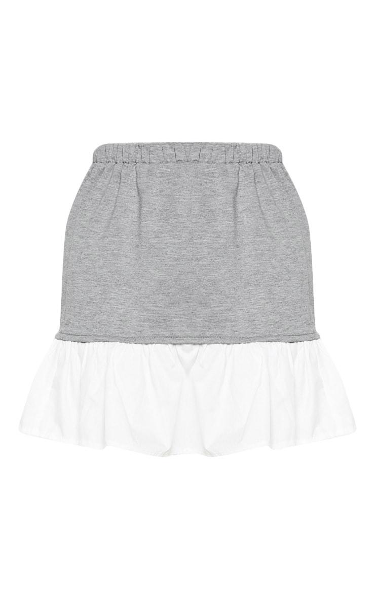 Mini-jupe en popeline grise à ourlet volanté contraste 3