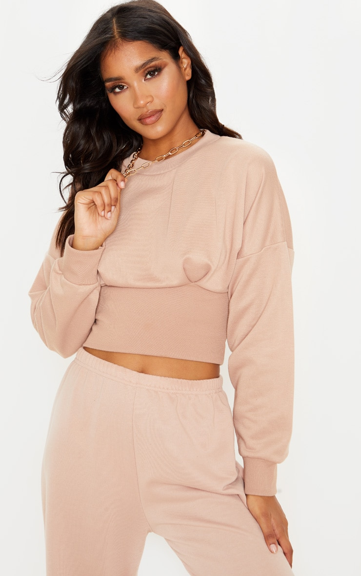 nude-rib-extreme-hem-crop-sweater by prettylittlething