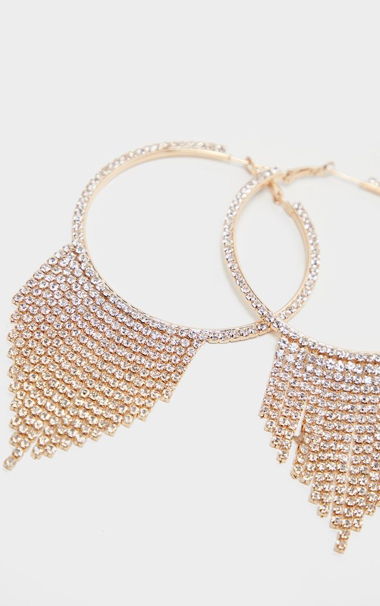 Boucles d'oreilles dorées à pompons pendants strassés 3