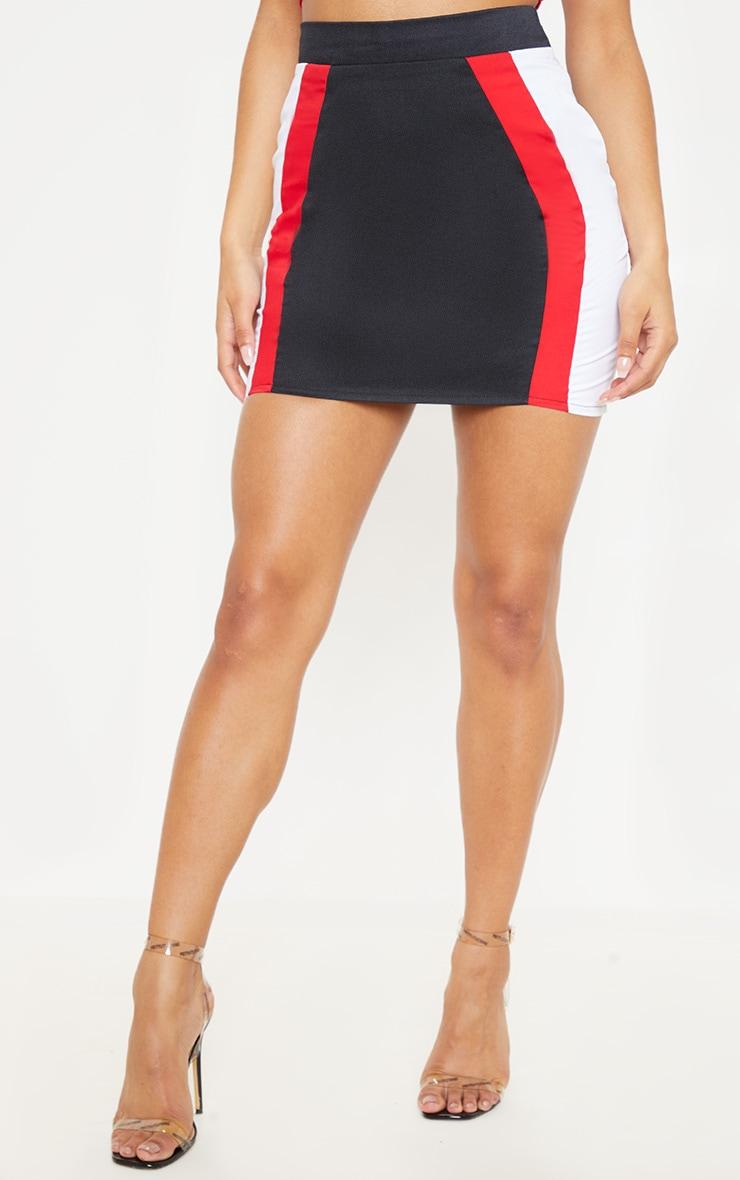 Mini-jupe noire à bandes rouges et blanches  2