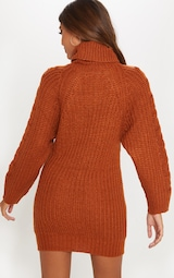 f848054f97bb Robe pull en maille tressée rouille. Tricots