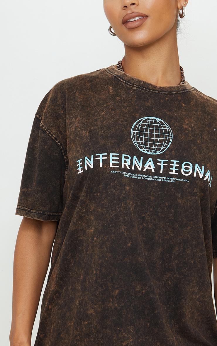 PRETTYLITTLETHING Rust Acid Wash International Slogan Oversized T Shirt Dress 4