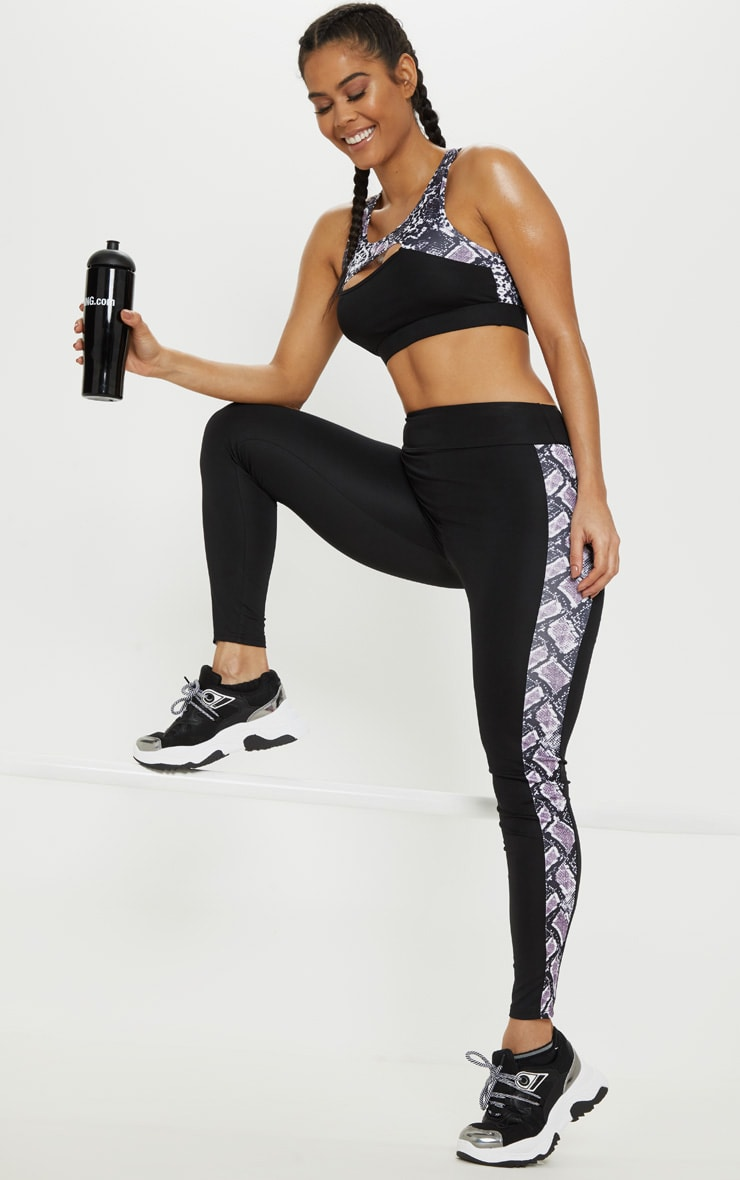 Legging de sport noir à bandes latérales imprimé serpent 1