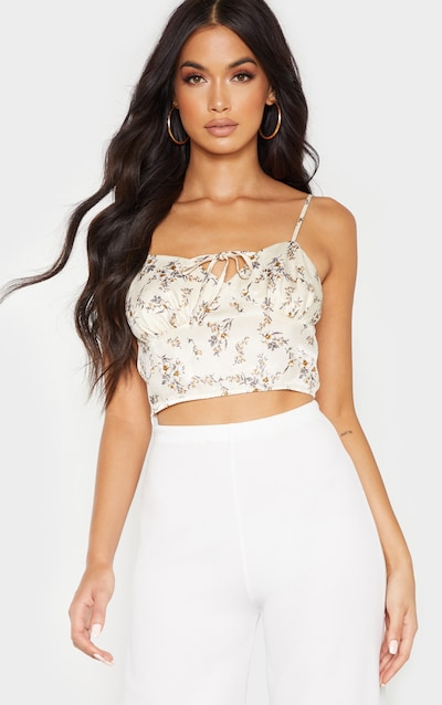 afd50a9d59a318 Cream Floral Printed Cup Tie Detail Sleeveless... $40.00. Cream Ribbed  Halterneck Button Crop Top