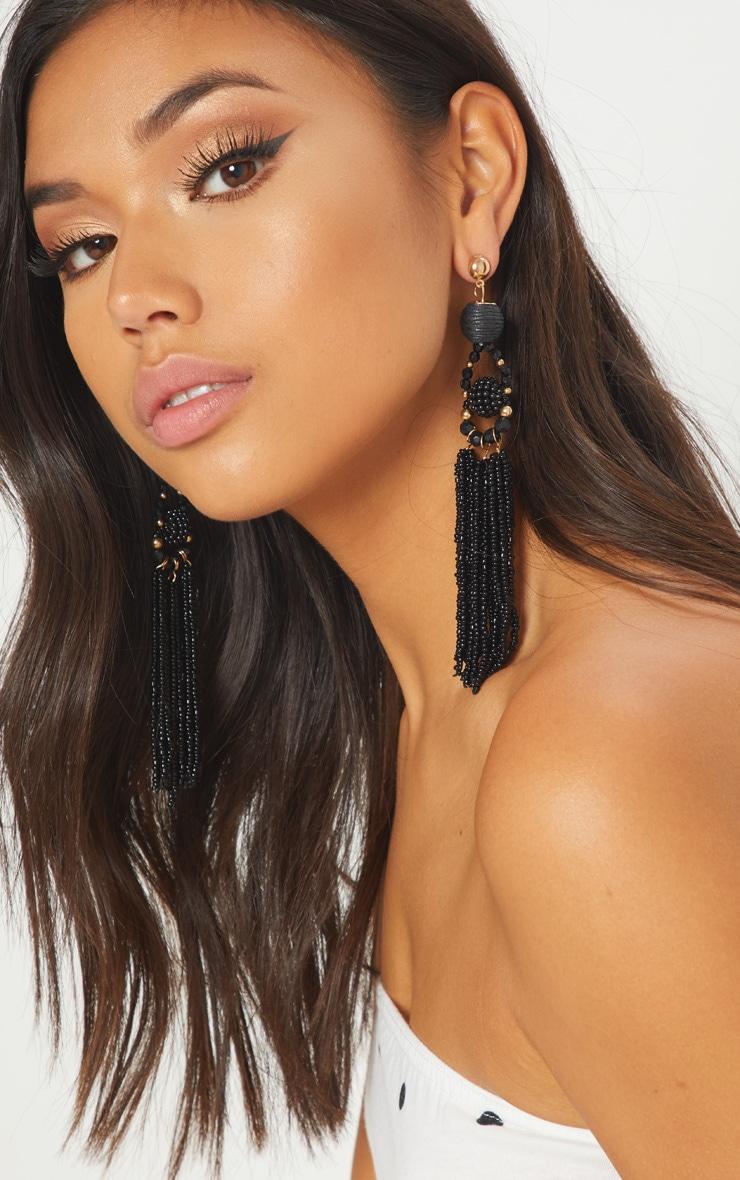 Boucles d'oreilles perlées à franges noires 1