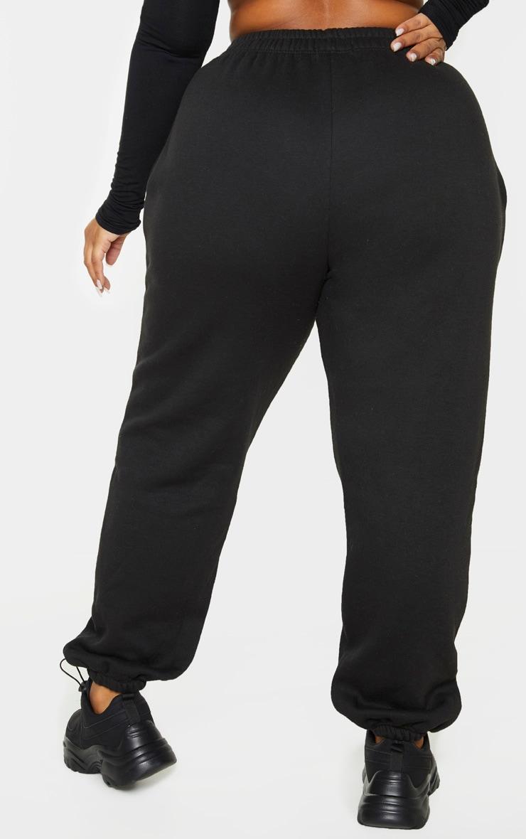 PRETTYLITTLETHING Plus Black Slogan Printed Track Pants 4