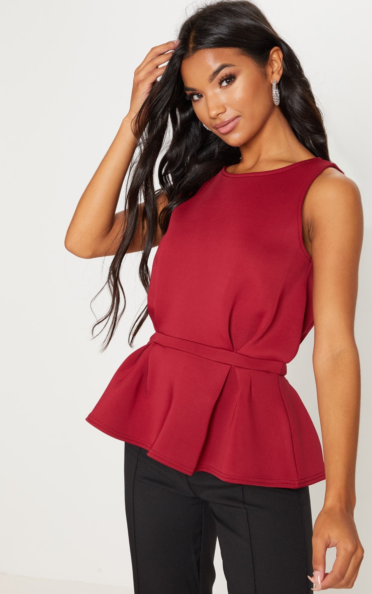 0b70033f1568d Deep Burgundy Scuba Sleeveless Peplum Top image 1