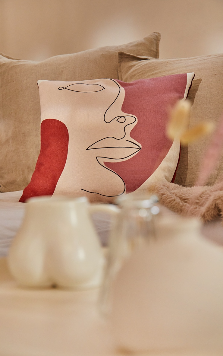 Rust Large Face Outline Filled Cushion 3