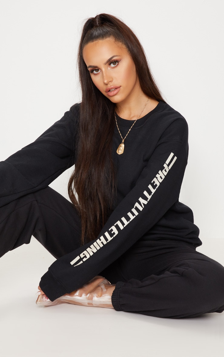 PRETTYLITTLETHING Black Logo Stripe Oversized Sweater 1