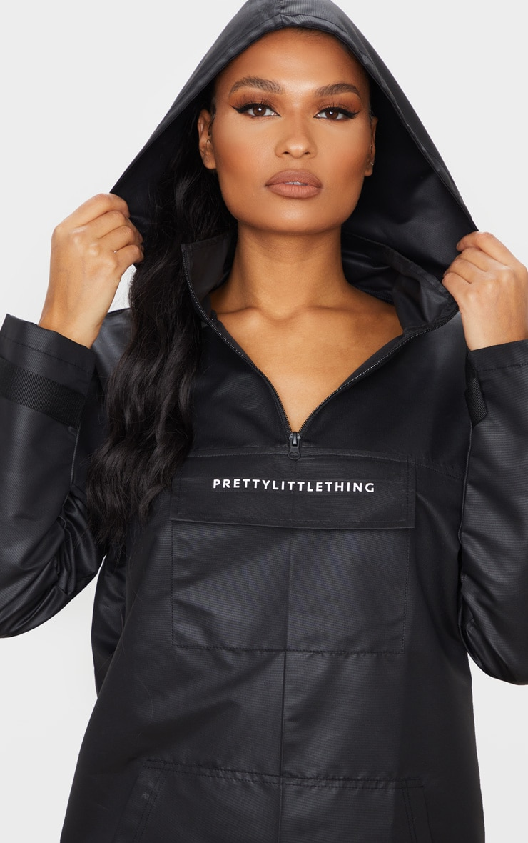 PRETTYLITTLETHING Black Pocket Front Hooded Pull Over Mac 4