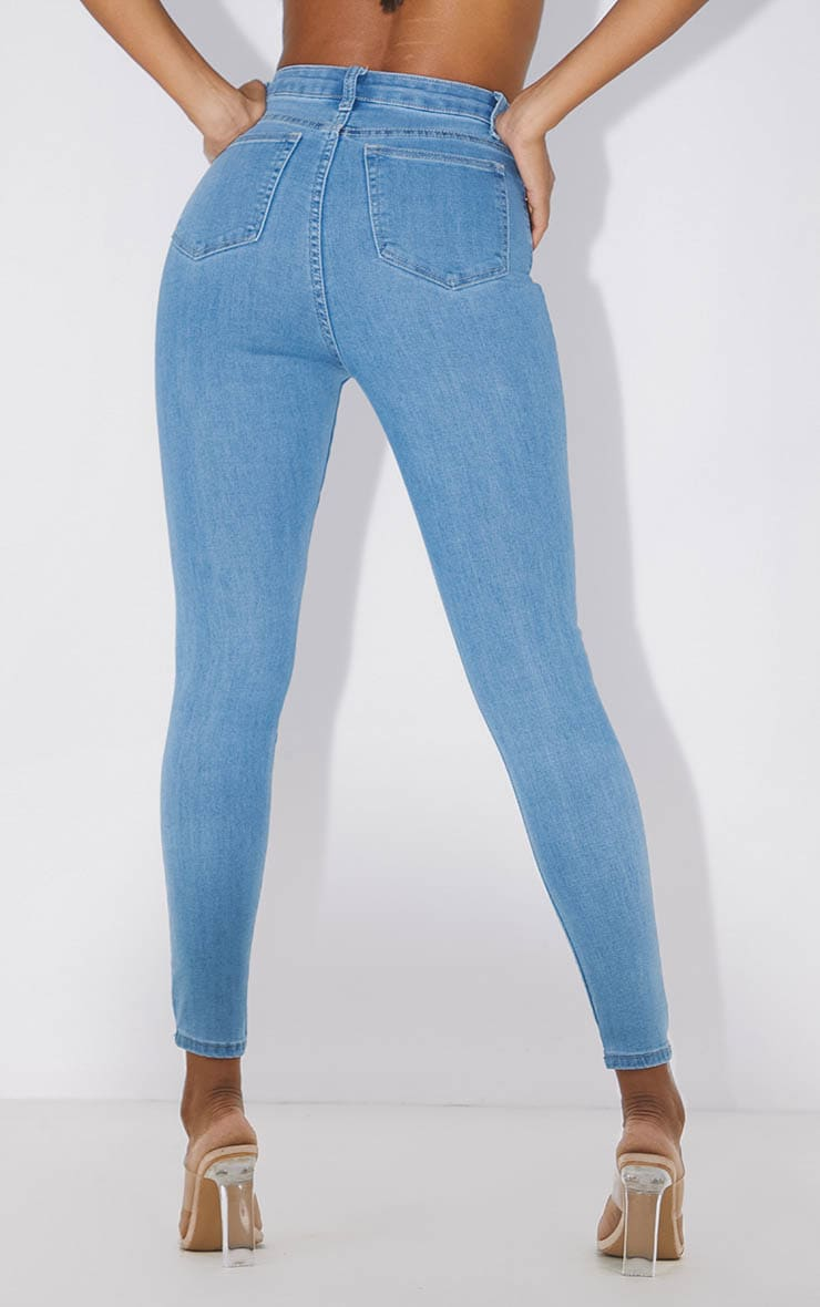 PRETTYLITTLETHING Light Wash Knee Rip 5 Pocket Skinny Jean 4
