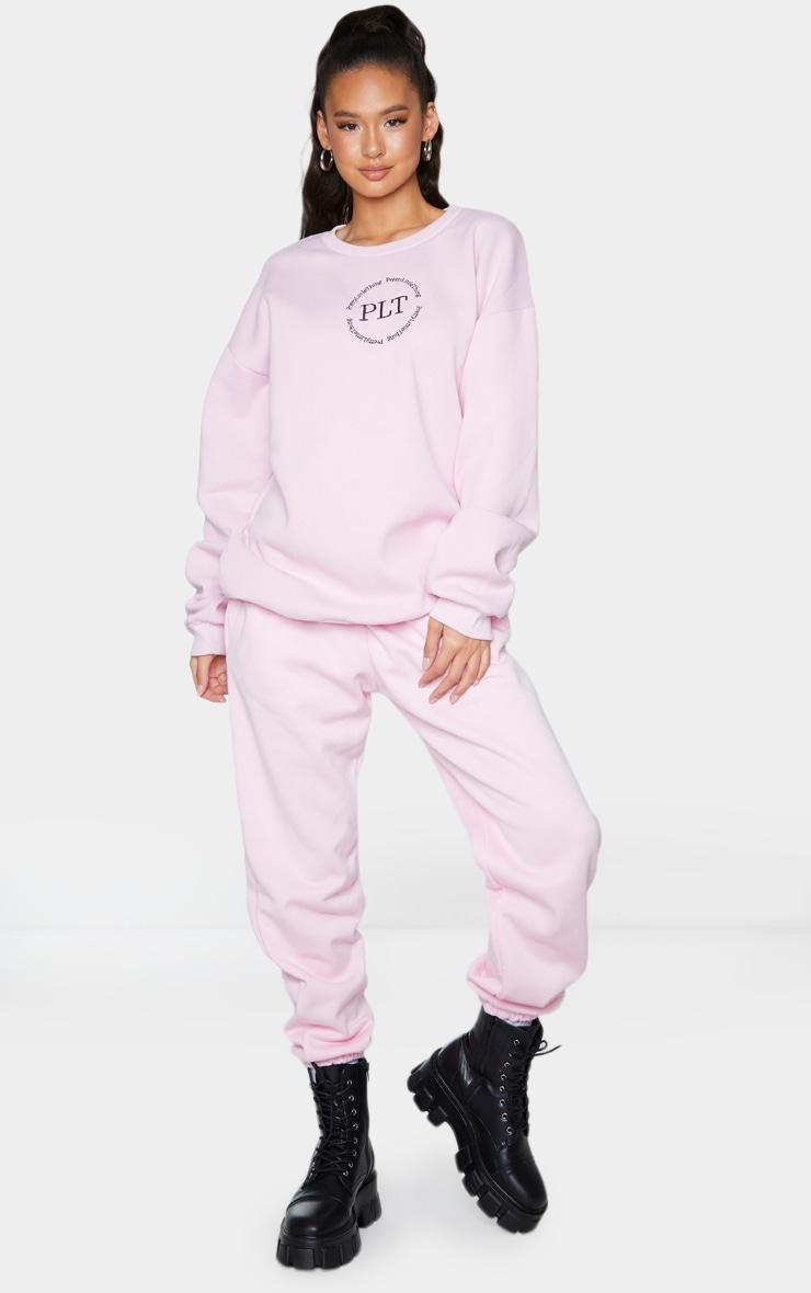 PRETTYLITTLETHING Baby Pink Circle Logo Sweatshirt 3