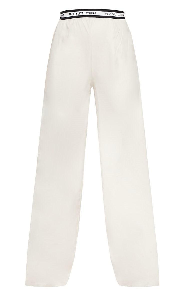 PRETTYLITTLETHING - Pantalon habillé gris pierre à jambes évasées et bande à slogan 3