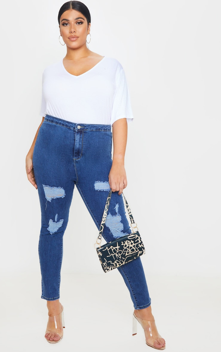 PRETTYLITTLETHING Plus Mid Blue Distressed Disco Jean 1