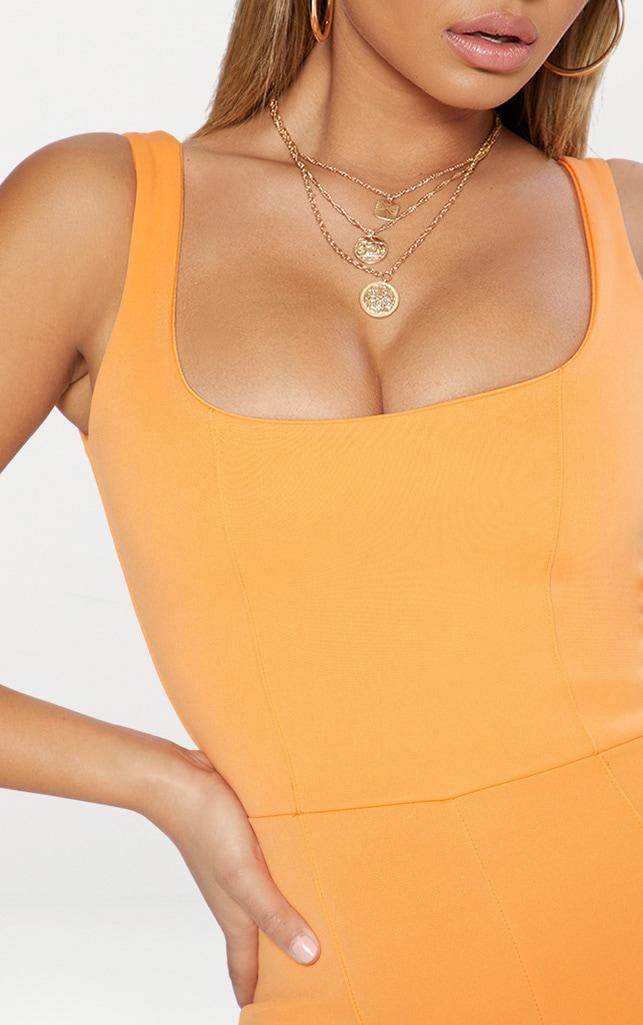Combinaison orange à encolure carrée et coutures apparentes 5