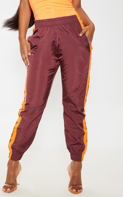 PRETTYLITTLETHING Burgundy Side Tape Shell Jogger