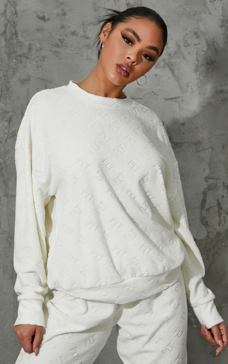 PRETTYLITTLETHING Cream Embossed Towelling Sweater 1