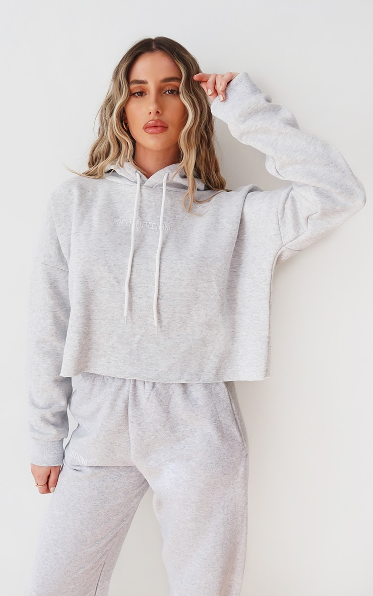 PRETTYLITTLETHING Ash Grey Embroidered Cropped Slogan Hoodie 1