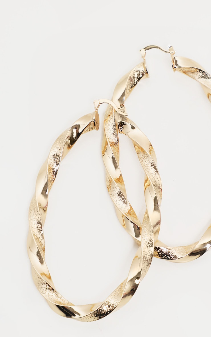 Gold Oval Shaped Twist Hoops 3