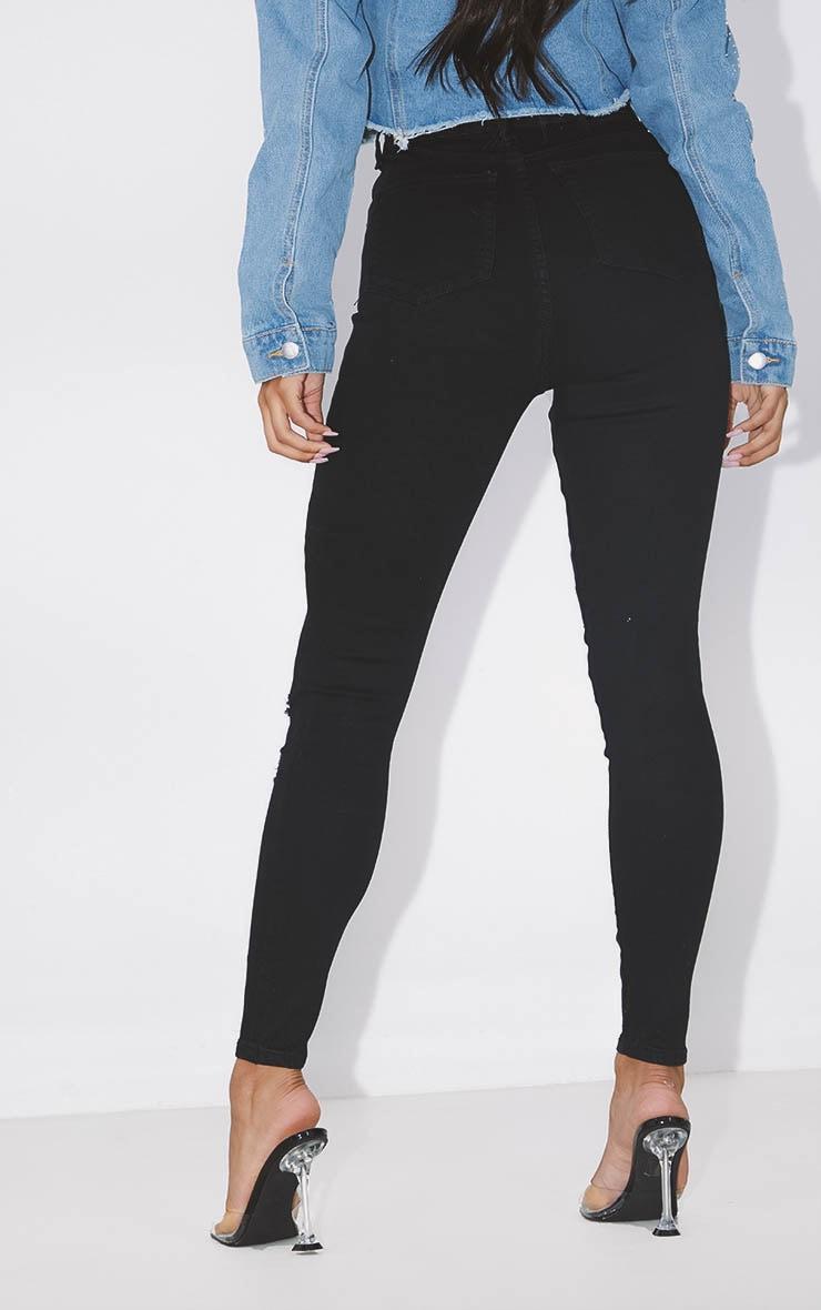 PRETTYLITTLETHING Black Distressed 5 Pocket Skinny Jean 4