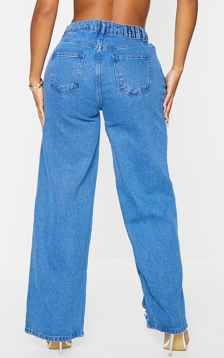 PRETTYLITTLETHING Shape Mid Blue Wash Lace Up Side Wide Leg Jeans 3