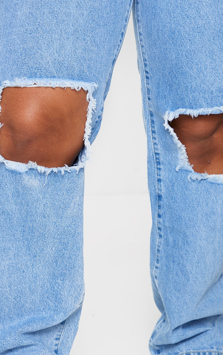 PRETTYLITTLETHING Plus Knee Rip Light Wash Straight Leg Jeans 4