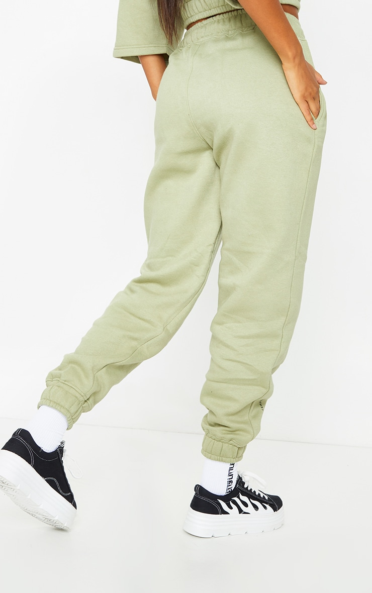 PRETTYLITTLETHING Olive Green Welcome To Our World Slogan Joggers 3