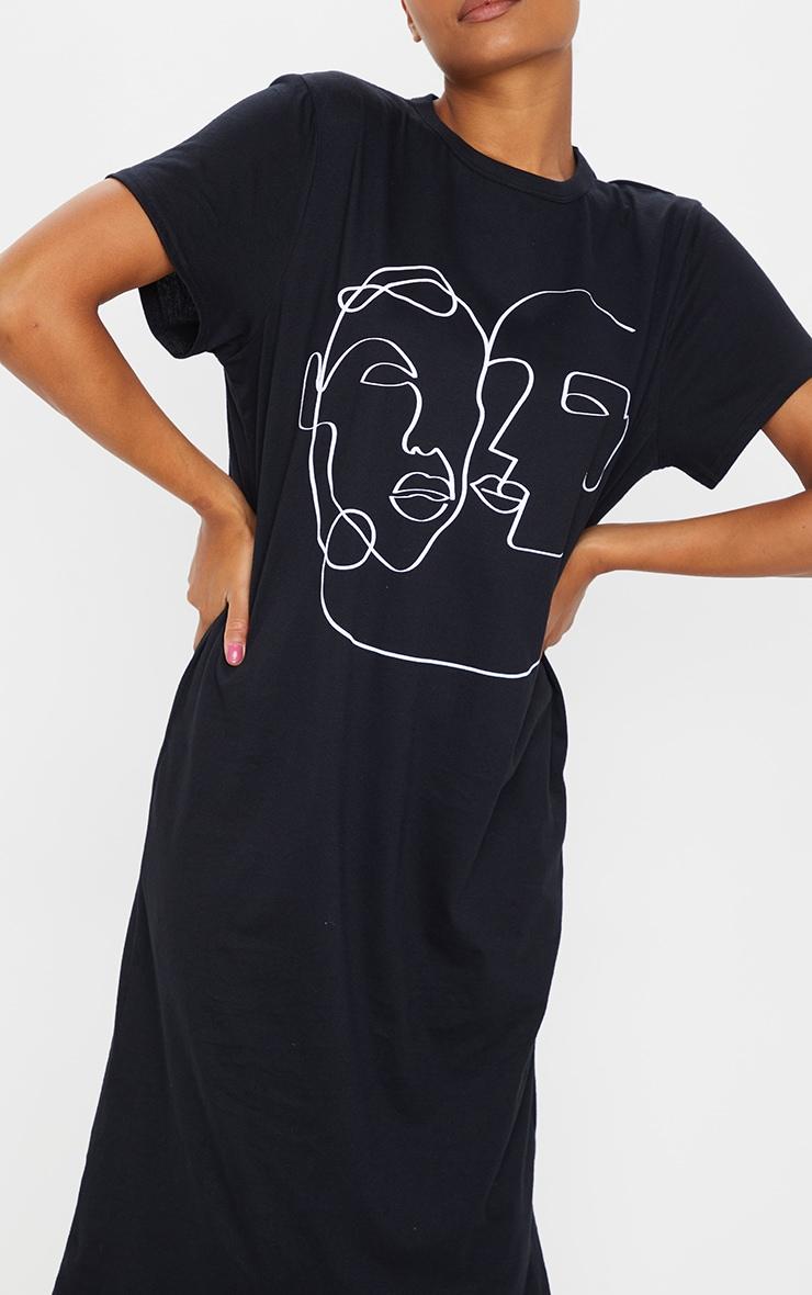 Robe mi-longue noire oversize à motif visages 4