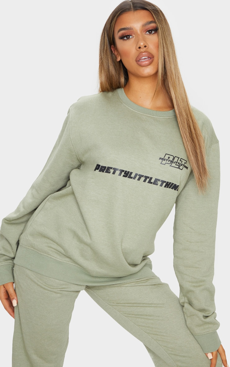PRETTYLITTLETHING Sage Green Slogan Oversized Sweater 1