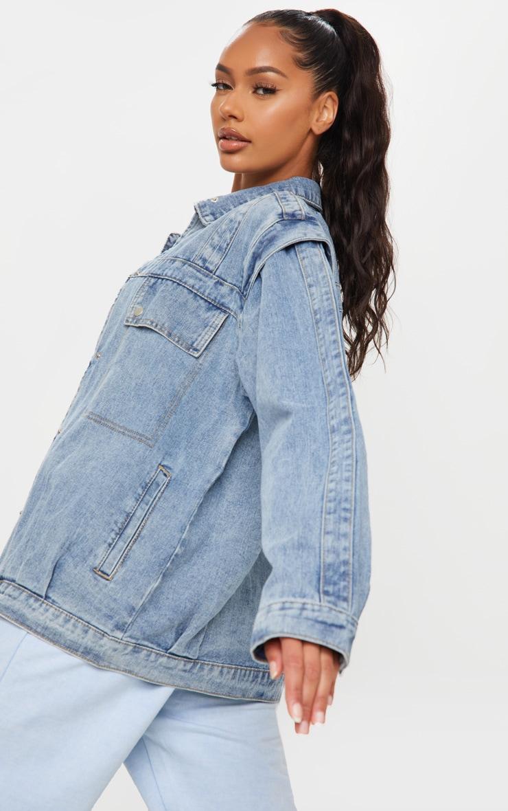 Veste en jean effet vintage oversize à grandes poches frontales 2