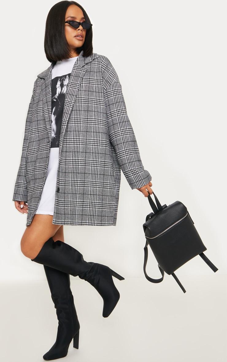 Veste en laine à carreaux noirs 1