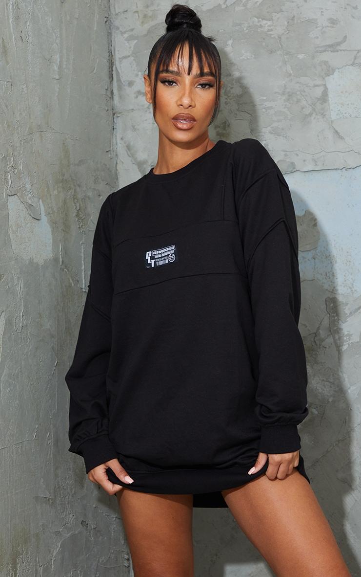 PRETTYLITTLETHING Badge Black Oversized Sweat Jumper Dress 1