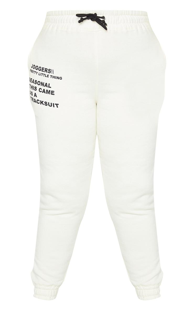 PRETTYLITTLETHING Plus Cream Slogan Printed Joggers 5