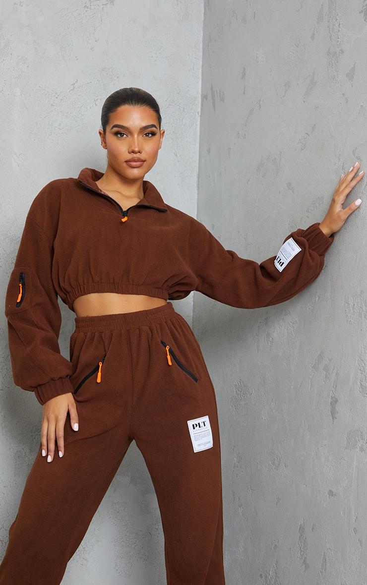 PRETTYLITTLETHING Chocolate Brown Badge Detail Cropped Zip Through Fleece 1