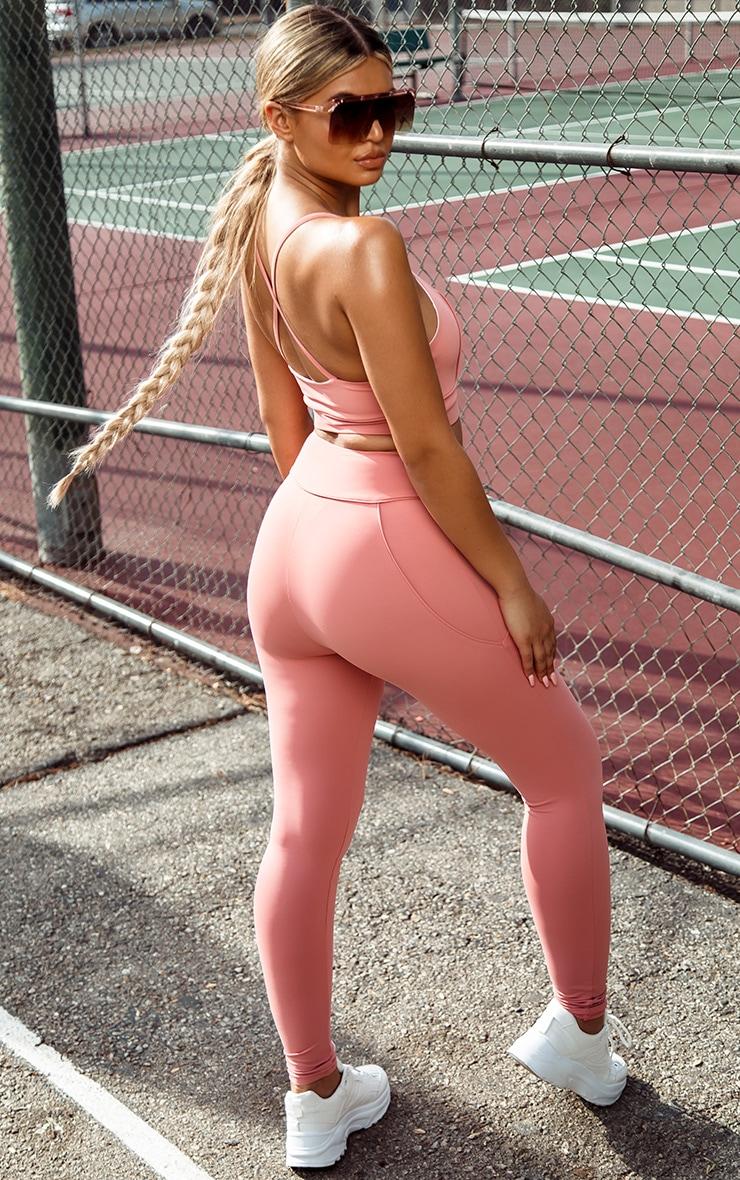 Legging de sport rose cendré taille haute à détail liserés  1