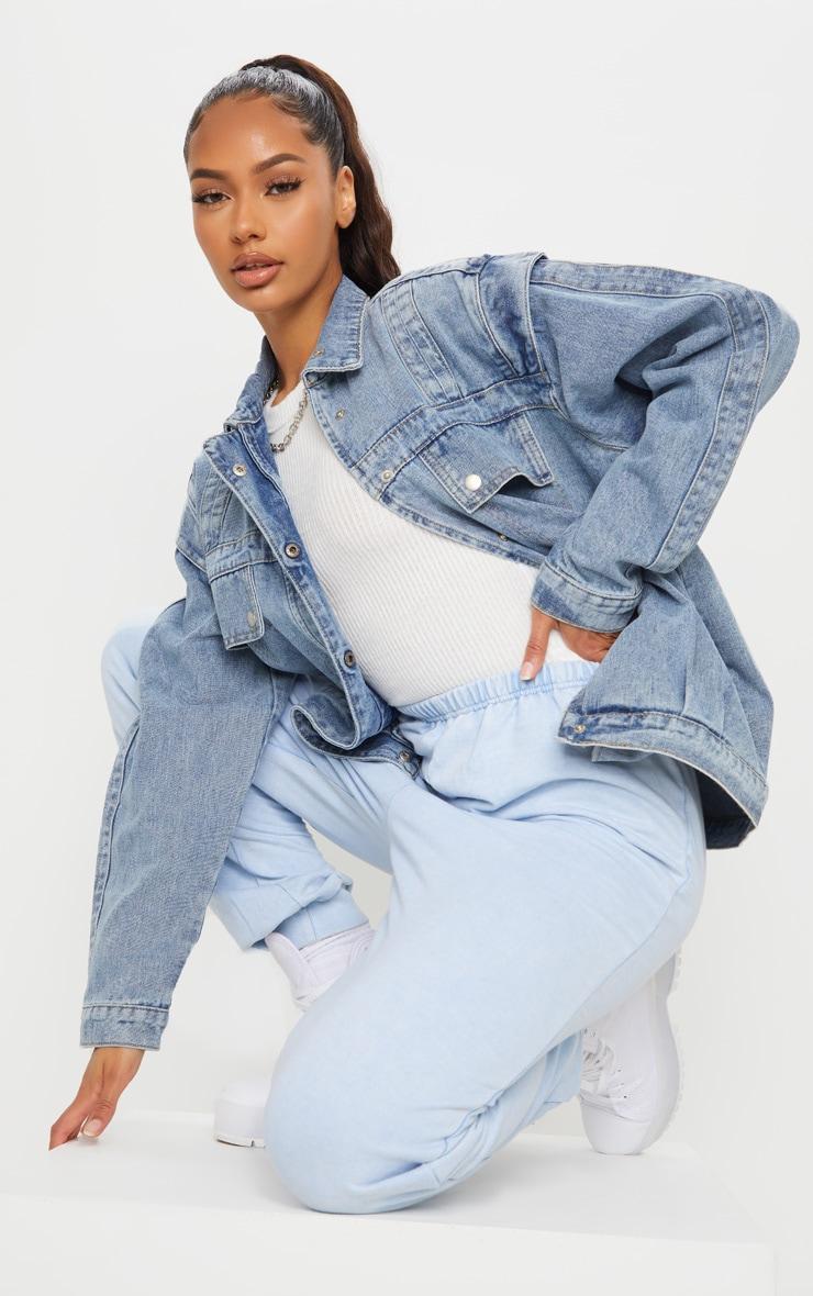 Veste en jean effet vintage oversize à grandes poches frontales 3