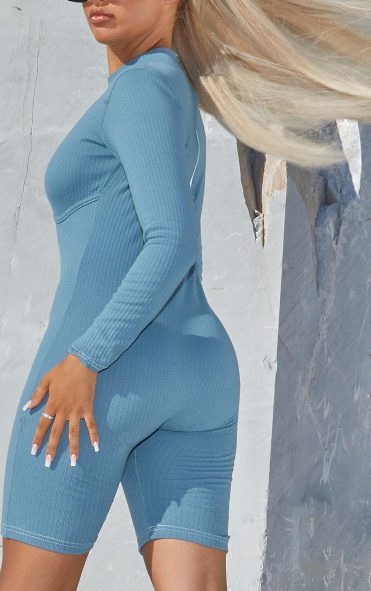 Combi moulante bleue en maille très côtelée à détail structurant et col haut  2