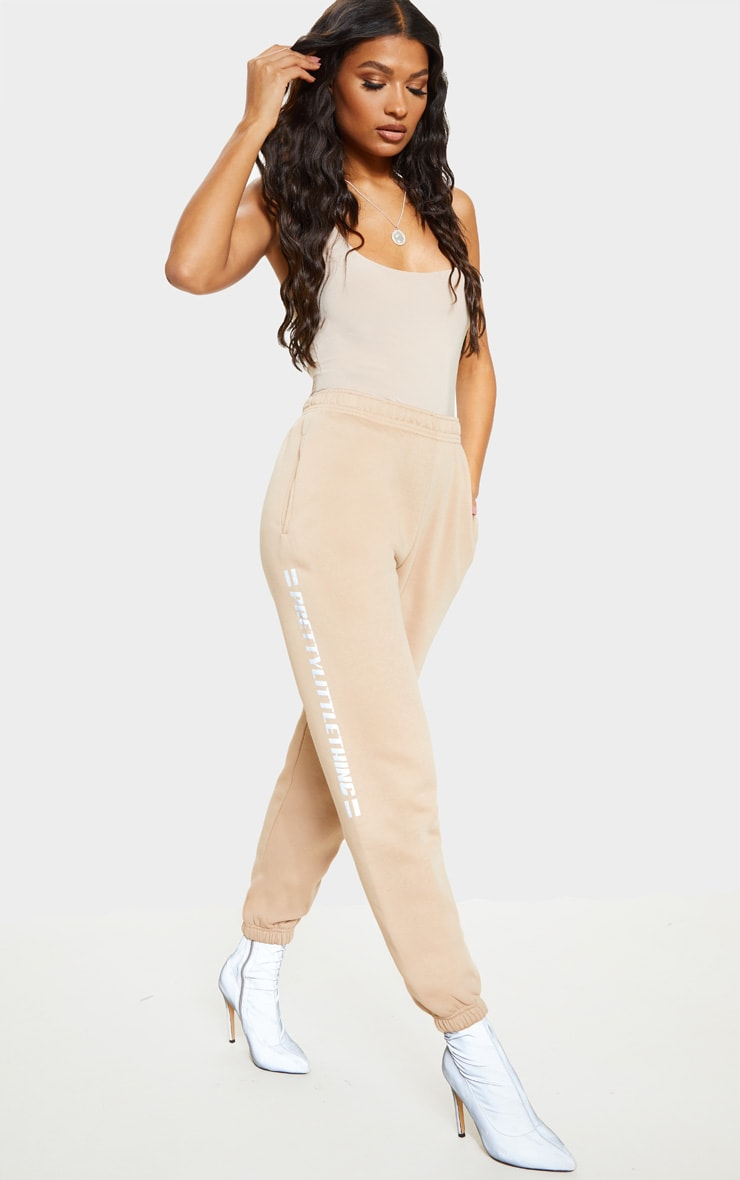 PRETTYLITTLETHING Taupe Reflective Print Track Pants 1