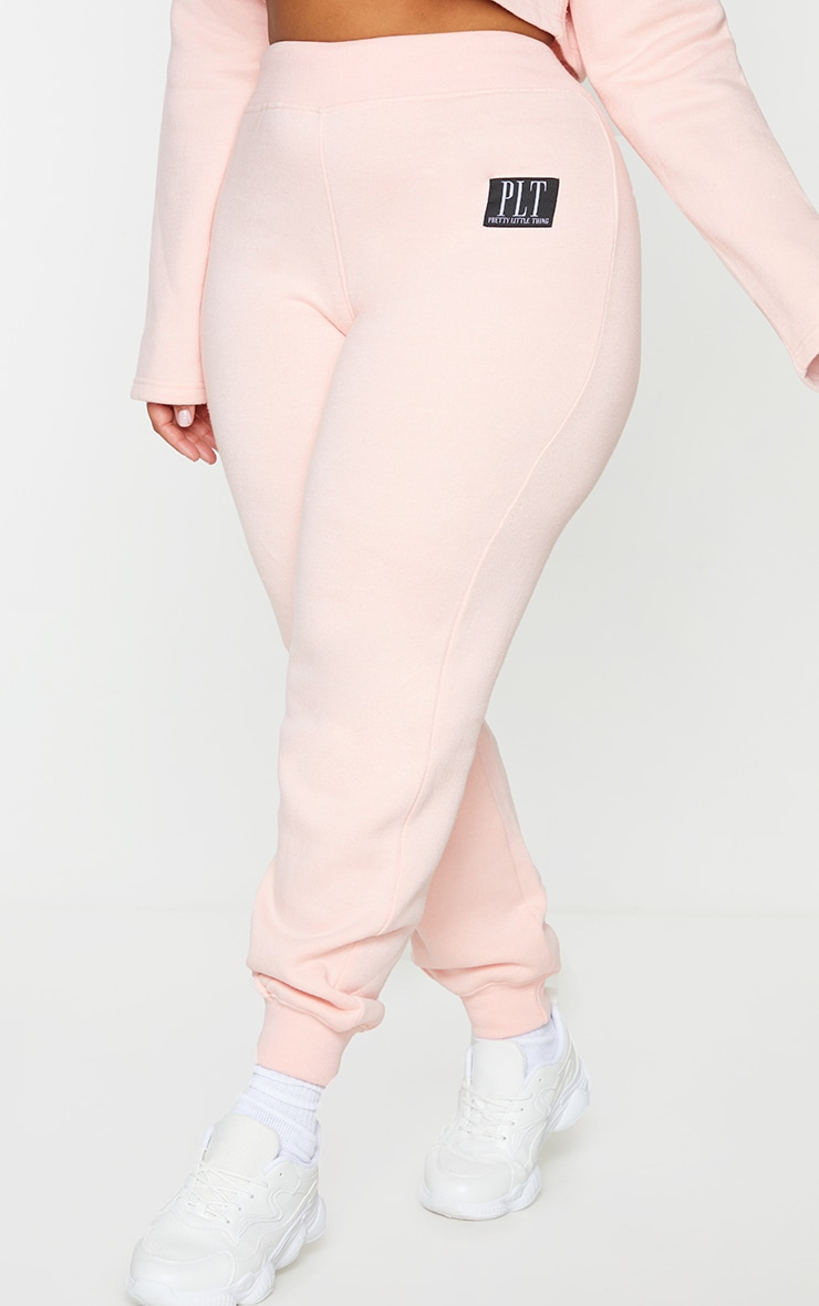 PRETTYLITTLETHING Plus Baby Pink Badge Detail Joggers 2
