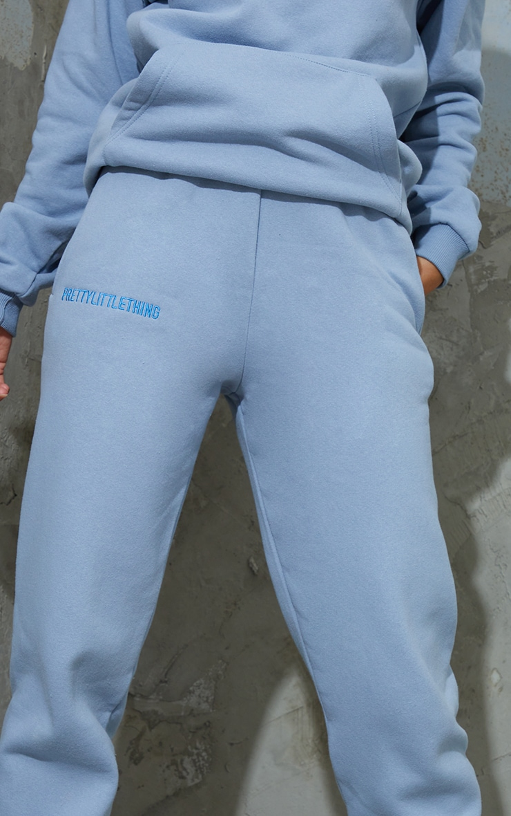 PRETTYLITTLETHING Dusty Blue Embroidered Slogan Joggers 4