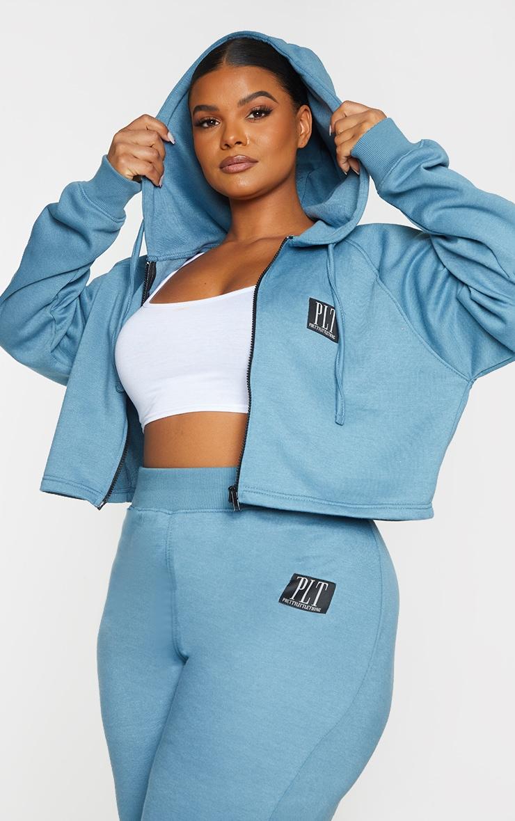 PRETTYLITTLETHING Plus Blue Badge Zip Up Cropped Hoodie 1