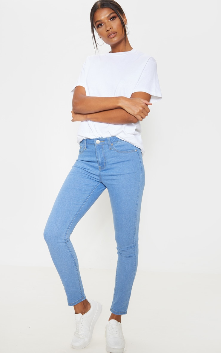 Jean skinny basique taille haute à 5 poches très délavé 1
