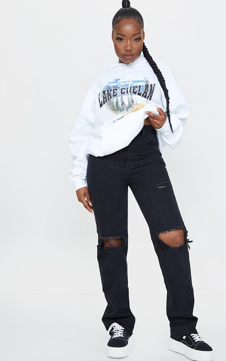 PRETTYLITTLETHING Petite Black Ripped Long Leg Straight Jeans 1