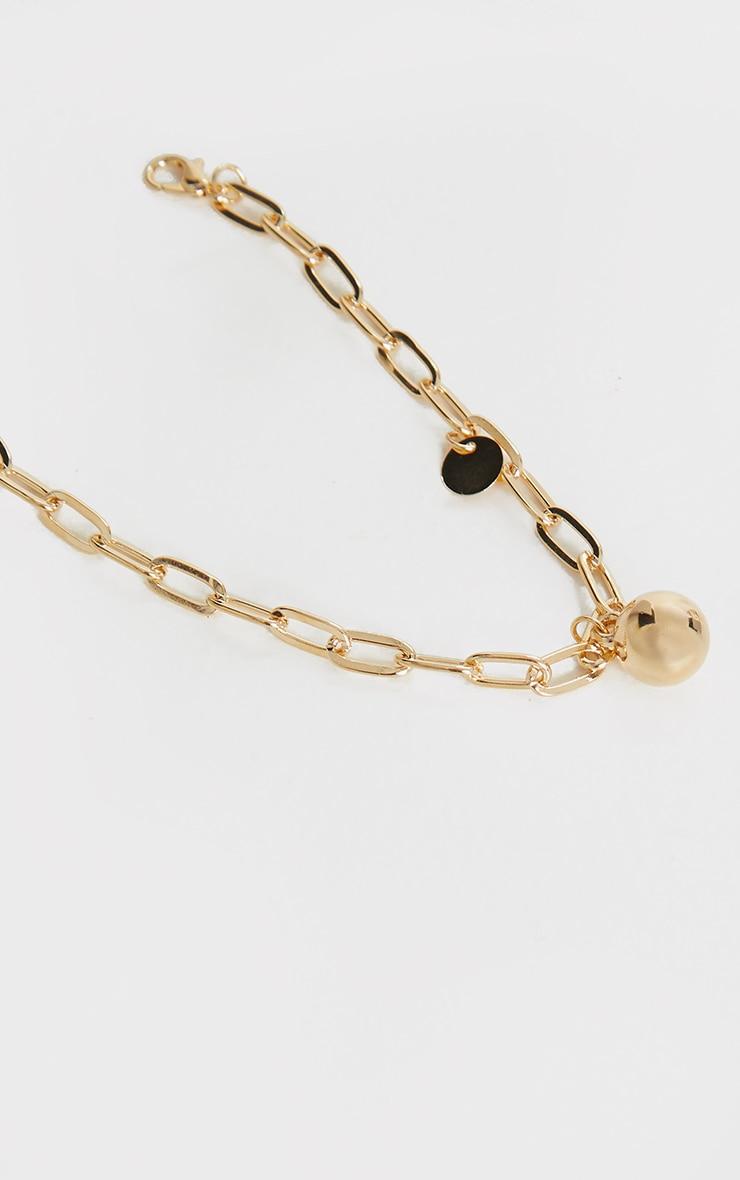 Chaîne de cheville dorée à pendentif boule 2