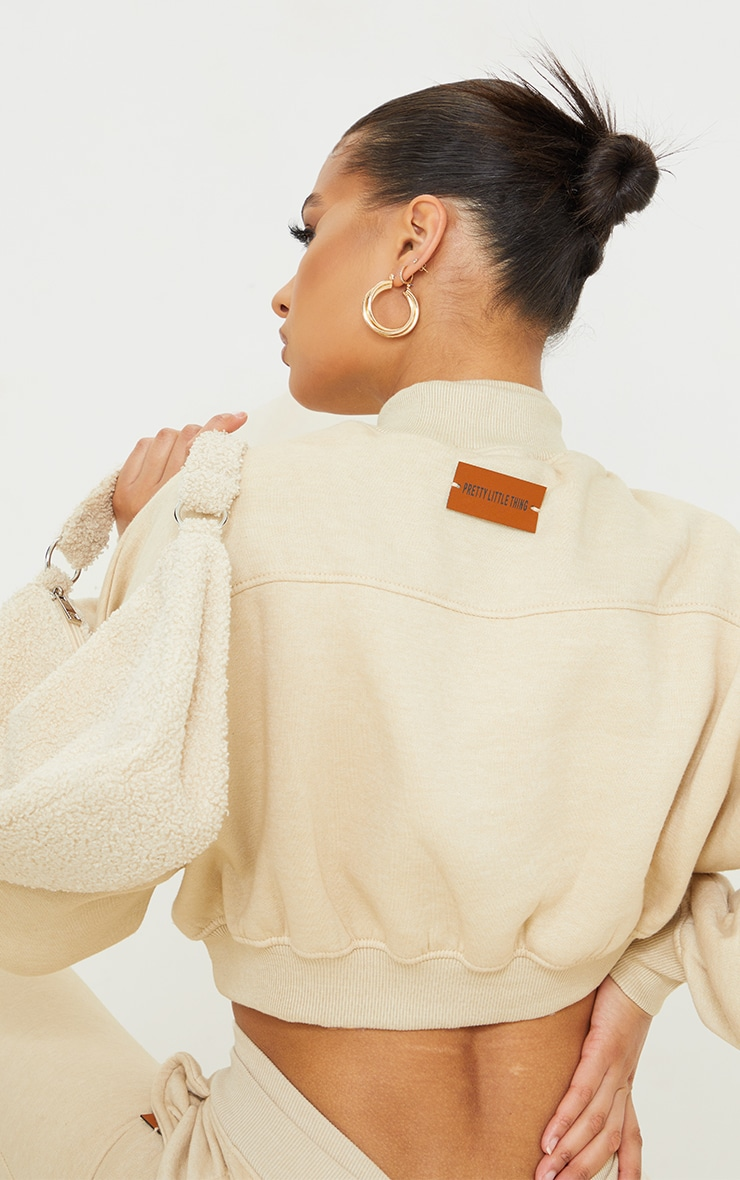 PRETTYLITTLETHING Stone Badge Back Detail Crop Sweater